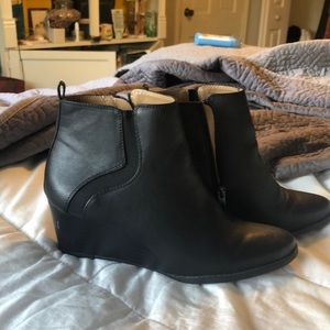 Heeled black booties